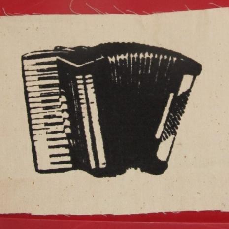 black accordion on white patch